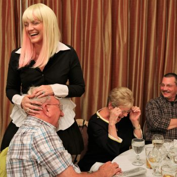 Murder mystery dinner guest laughs out loud