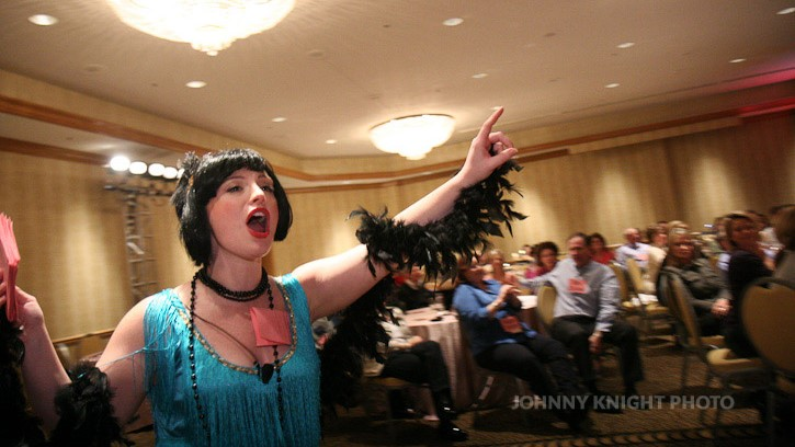 1920's flapper making accusations at company Christmas party murder mystery